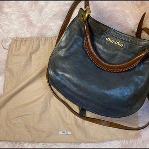 miu miu coffer fold over flap two way leather bag